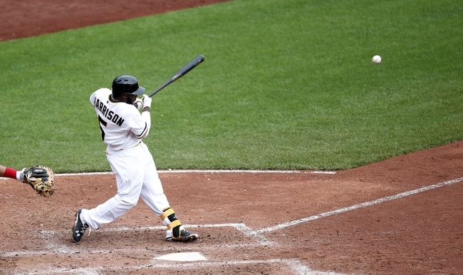 Aug 31, 2014; Pittsburgh, PA, USA; Pittsburgh Pirates third baseman Josh Harrison (5) singles to left field against the Cincinnati Reds during the eighth inning at PNC Park. The Reds won 3-2. Mandatory Credit: Charles LeClaire-USA TODAY Sports