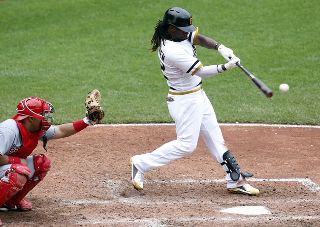 Aug 31, 2014; Pittsburgh, PA, USA; Pittsburgh Pirates center fielder Andrew McCutchen (22) singles against the Cincinnati Reds during the eighth inning at PNC Park. The Reds won 3-2. Mandatory Credit: Charles LeClaire-USA TODAY Sports