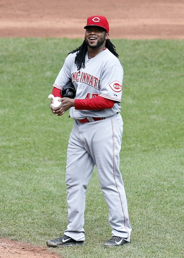 Aug 31, 2014; Pittsburgh, PA, USA; Cincinnati Reds starting pitcher Johnny Cueto (47) reacts to being jeered by the Pittsburgh Pirates fans during the sixth inning at PNC Park. The Reds won 3-2. Mandatory Credit: Charles LeClaire-USA TODAY Sports
