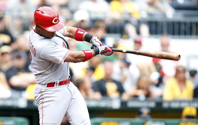 Aug 31, 2014; Pittsburgh, PA, USA; Cincinnati Reds shortstop Ramon Santiago (7) singles against the Pittsburgh Pirates during the fifth inning at PNC Park. The Reds won 3-2. Mandatory Credit: Charles LeClaire-USA TODAY Sports