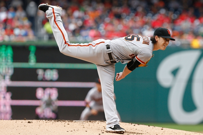 Aug 23, 2014; Washington, DC, USA; San Francisco Giants starting pitcher Tim Lincecum (55) pitches against the Washington Nationals at Nationals Park. Mandatory Credit: Geoff Burke-USA TODAY Sports