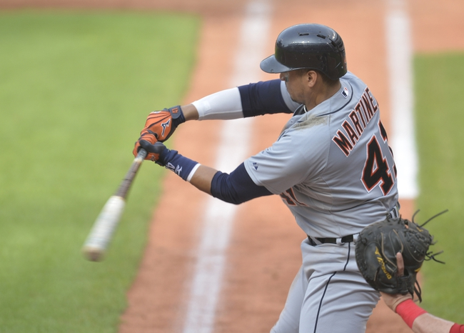 Sep 1, 2014; Cleveland, OH, USA; Detroit Tigers first baseman Victor Martinez (41) hits a two-run home run in the third inning against the Cleveland Indians at Progressive Field. Mandatory Credit: David Richard-USA TODAY Sports