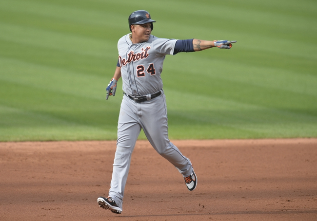 Sep 1, 2014; Cleveland, OH, USA; Detroit Tigers designated hitter Miguel Cabrera (24) reacts after a two-run home run by first baseman Victor Martinez (not pictured) in the third inning against the Cleveland Indians at Progressive Field. Mandatory Credit: David Richard-USA TODAY Sports