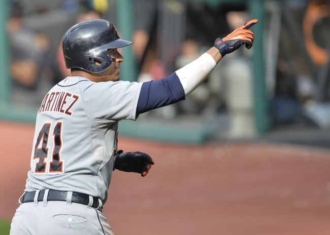 Sep 1, 2014; Cleveland, OH, USA; Detroit Tigers first baseman Victor Martinez (41) celebrates a two-run home run in the third inning against the Cleveland Indians at Progressive Field. Mandatory Credit: David Richard-USA TODAY Sports