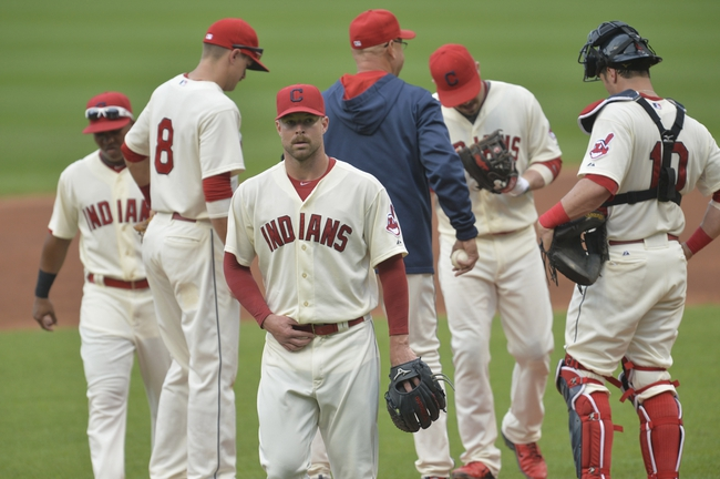 Sep 1, 2014; Cleveland, OH, USA; Cleveland Indians starting pitcher Corey Kluber (third from left) reacts after being taken from the game in the third inning against the Detroit Tigers at Progressive Field. Mandatory Credit: David Richard-USA TODAY Sports