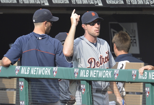 Sep 1, 2014; Cleveland, OH, USA; Detroit Tigers starting pitcher Max Scherzer (37) reacts after a solo home run by left fielder J.D. Martinez (not pictured) in the third inning against the Cleveland Indians at Progressive Field. Mandatory Credit: David Richard-USA TODAY Sports