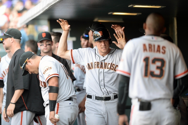 Sep 1, 2014; Denver, CO, USA; San Francisco Giants right fielder Hunter Pence (8) celebrates after scoring in the fifth inning against the Colorado Rockies at Coors Field. Mandatory Credit: Ron Chenoy-USA TODAY Sports