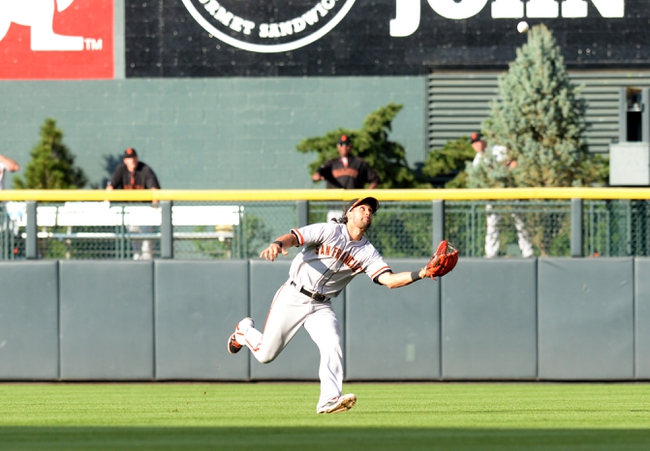 Sep 1, 2014; Denver, CO, USA; San Francisco Giants shortstop Brandon Crawford (35) prepares to bring in a short pop up in the fifth inning against the Colorado Rockies at Coors Field. Mandatory Credit: Ron Chenoy-USA TODAY Sports