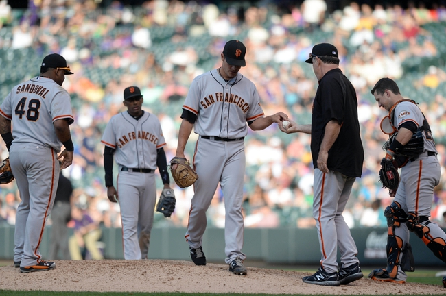 Sep 1, 2014; Denver, CO, USA; San Francisco Giants relief pitcher Javier Lopez (49) is removed from the mound by manager Bruce Bochy (15) in the sixth inning against the Colorado Rockies at Coors Field. Mandatory Credit: Ron Chenoy-USA TODAY Sports