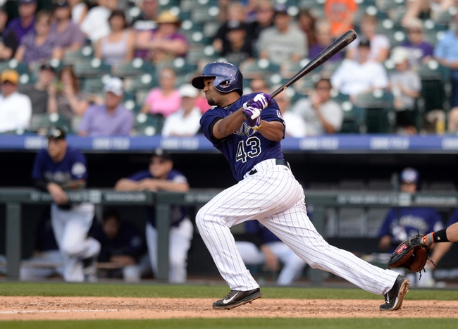 Sep 1, 2014; Denver, CO, USA; Colorado Rockies pinch hitter Rafael Ynoa (43) hits an RBI single in the sixth inning against the San Francisco Giants at Coors Field. Mandatory Credit: Ron Chenoy-USA TODAY Sports