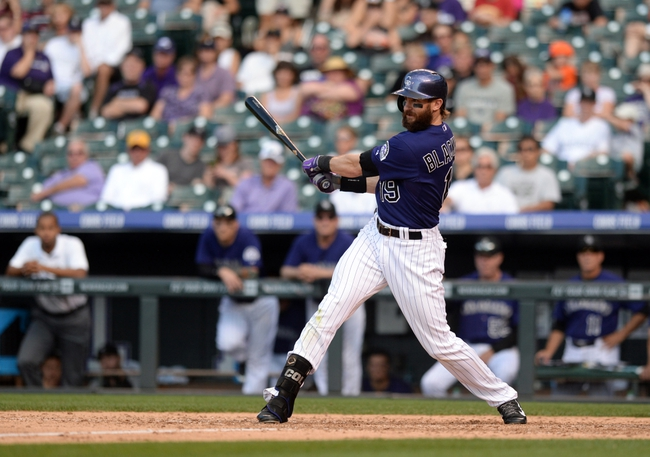 Sep 1, 2014; Denver, CO, USA; Colorado Rockies pinch hitter Rafael Ynoa (43) hits an RBI during a fielders choice in the sixth inning against the San Francisco Giants at Coors Field. Mandatory Credit: Ron Chenoy-USA TODAY Sports