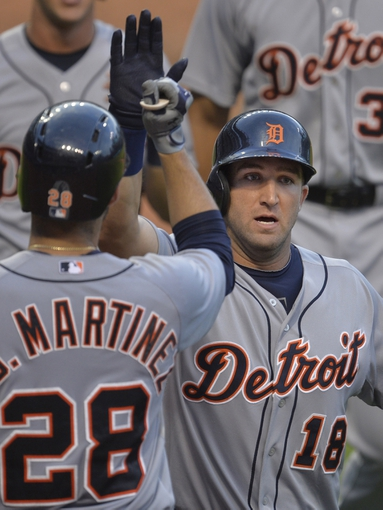 Sep 1, 2014; Cleveland, OH, USA; Detroit Tigers pinch hitter Tyler Collins (18) celebrates his three-run home run in the ninth inning against the Cleveland Indians at Progressive Field. Mandatory Credit: David Richard-USA TODAY Sports