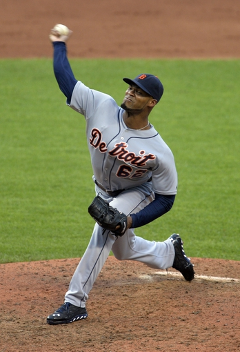 Sep 1, 2014; Cleveland, OH, USA; Detroit Tigers relief pitcher Al Alburquerque (62) delivers in the eighth inning against the Cleveland Indians at Progressive Field. Mandatory Credit: David Richard-USA TODAY Sports