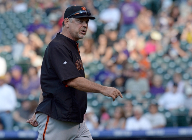 Sep 1, 2014; Denver, CO, USA; San Francisco Giants manager Bruce Bochy (15) walks off the mound in the sixth inning against the Colorado Rockies at Coors Field. Mandatory Credit: Ron Chenoy-USA TODAY Sports