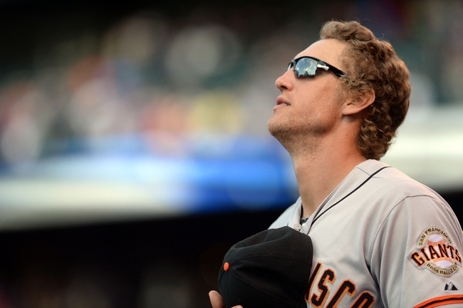 Sep 1, 2014; Denver, CO, USA; San Francisco Giants right fielder Hunter Pence (8) listens to God Bless American in the seventh inning against the Colorado Rockies at Coors Field. Mandatory Credit: Ron Chenoy-USA TODAY Sports