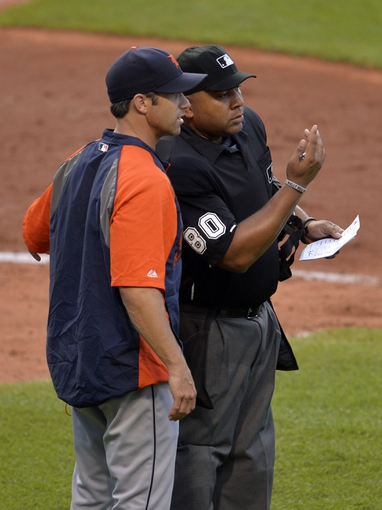 Sep 1, 2014; Cleveland, OH, USA; Detroit Tigers manager Brad Ausmus (7) talks with home plate umpire Adrian Johnson (80) in the seventh inning against the Cleveland Indians at Progressive Field. Mandatory Credit: David Richard-USA TODAY Sports