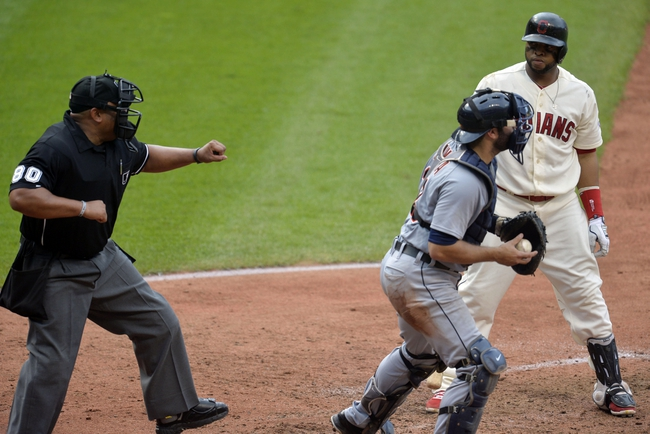 Sep 1, 2014; Cleveland, OH, USA; Detroit Tigers catcher Alex Avila (13) heads to the dugout as home plate umpire Adrian Johnson (80) calls a third strike on Cleveland Indians first baseman Carlos Santana (41) in the fifth inning at Progressive Field. Mandatory Credit: David Richard-USA TODAY Sports