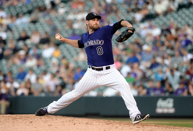 Sep 1, 2014; Denver, CO, USA; Colorado Rockies relief pitcher Adam Ottavino (0) delivers a pitch in the eighth inning against the San Francisco Giants at Coors Field. Mandatory Credit: Ron Chenoy-USA TODAY Sports