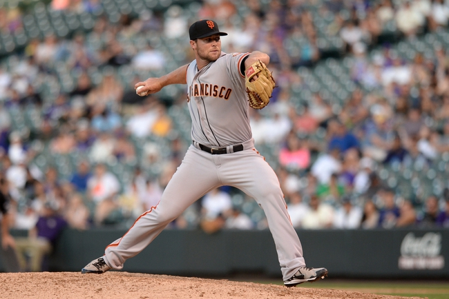 Sep 1, 2014; Denver, CO, USA; San Francisco Giants relief pitcher Jean Machi (63) delivers a pitch in the eighth inning against the Colorado Rockies at Coors Field. Mandatory Credit: Ron Chenoy-USA TODAY Sports