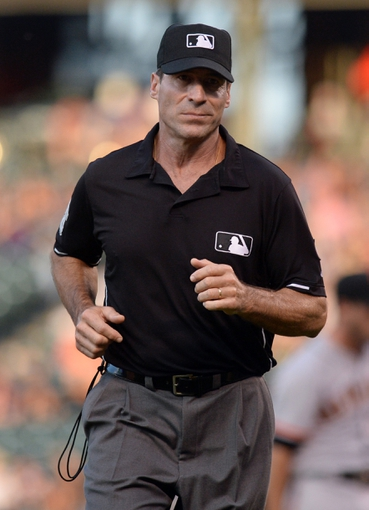 Sep 1, 2014; Denver, CO, USA; MLB second base umpire Angel Hernandez (55) heads to confirm a replay in the eighth inning of the game between the San Francisco Giants against the Colorado Rockies at Coors Field. Mandatory Credit: Ron Chenoy-USA TODAY Sports