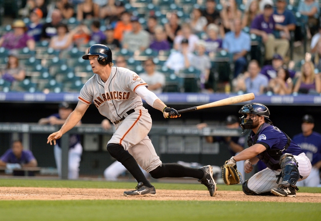 Sep 1, 2014; Denver, CO, USA; San Francisco Giants right fielder Hunter Pence (8) singles in the ninth inning against the Colorado Rockies at Coors Field. Mandatory Credit: Ron Chenoy-USA TODAY Sports