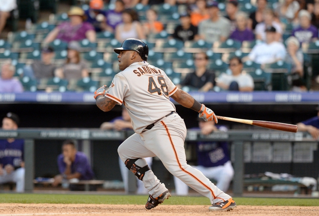 Sep 1, 2014; Denver, CO, USA;San Francisco Giants third baseman Pablo Sandoval (48) hits an RBI single to tie the game in the ninth inning against the Colorado Rockies at Coors Field. Mandatory Credit: Ron Chenoy-USA TODAY Sports