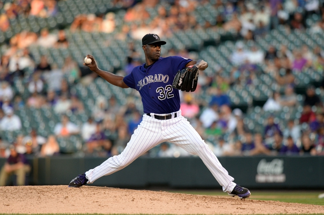 Sep 1, 2014; Denver, CO, USA; Colorado Rockies relief pitcher LaTroy Hawkins (32) delivers a pitch in the ninth inning against the San Francisco Giants at Coors Field. Mandatory Credit: Ron Chenoy-USA TODAY Sports