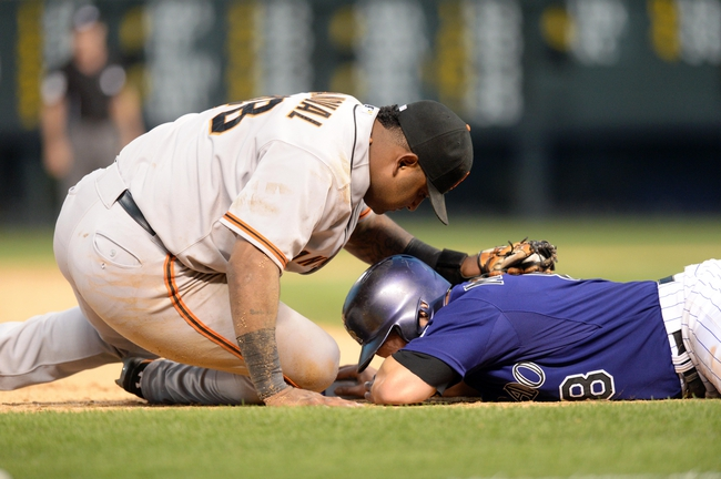 Sep 1, 2014; Denver, CO, USA; San Francisco Giants third baseman Pablo Sandoval (48) is unable to complete a tag out of Colorado Rockies catcher Michael McKenry (8) in the ninth inning at Coors Field. The Rockies defeated the Giants 10-9. Mandatory Credit: Ron Chenoy-USA TODAY Sports