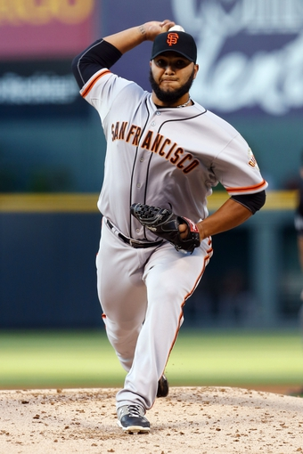 Sep 2, 2014; Denver, CO, USA; San Francisco Giants starting pitcher Yusmeiro Petit (52) pitches in the first inning against the Colorado Rockies at Coors Field. Mandatory Credit: Isaiah J. Downing-USA TODAY Sports