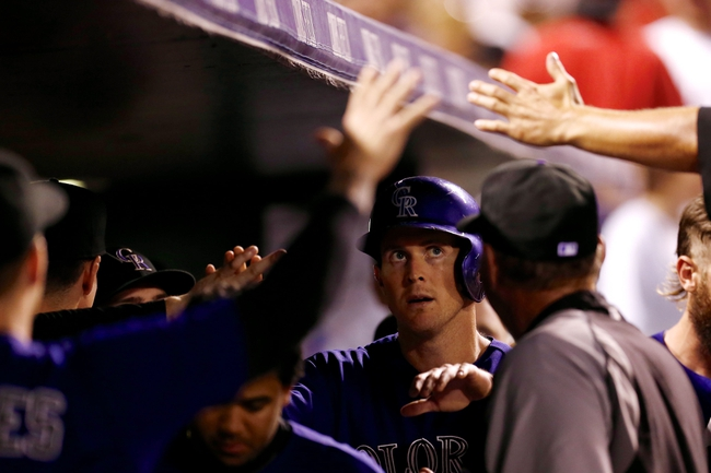 Sep 2, 2014; Denver, CO, USA; Colorado Rockies center fielder Drew Stubbs (13) celebrates in the dugout after scoring on an RBI in the fifth inning against the San Francisco Giants at Coors Field. Mandatory Credit: Isaiah J. Downing-USA TODAY Sports