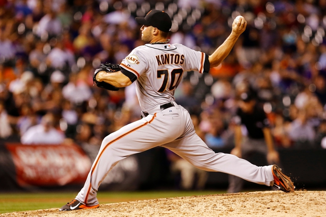 Sep 2, 2014; Denver, CO, USA; San Francisco Giants relief pitcher George Kontos (70) pitches in the sixth inning against the Colorado Rockies at Coors Field. Mandatory Credit: Isaiah J. Downing-USA TODAY Sports