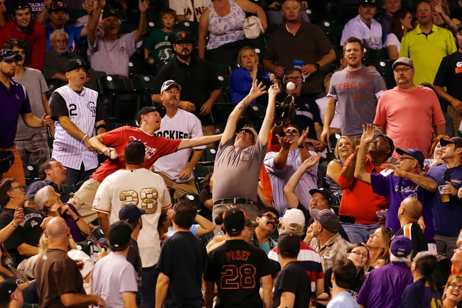 Sep 2, 2014; Denver, CO, USA; Fans reach for a foul ball in the sixth inning of the game between the San Francisco Giants and the Colorado Rockies at Coors Field. Mandatory Credit: Isaiah J. Downing-USA TODAY Sports