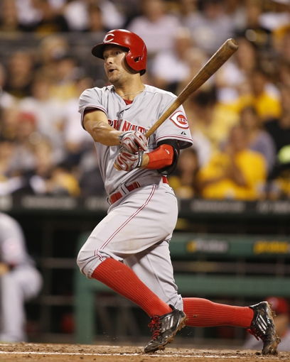Aug 29, 2014; Pittsburgh, PA, USA; Cincinnati Reds second baseman Kris Negron (17) at bat against the Pittsburgh Pirates during the seventh inning at PNC Park. The Pirates won 2-1. Mandatory Credit: Charles LeClaire-USA TODAY Sports