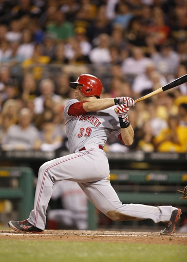 Aug 29, 2014; Pittsburgh, PA, USA; Cincinnati Reds catcher Devin Mesoraco (39) singles against the Pittsburgh Pirates during the seventh inning at PNC Park. The Pirates won 2-1. Mandatory Credit: Charles LeClaire-USA TODAY Sports