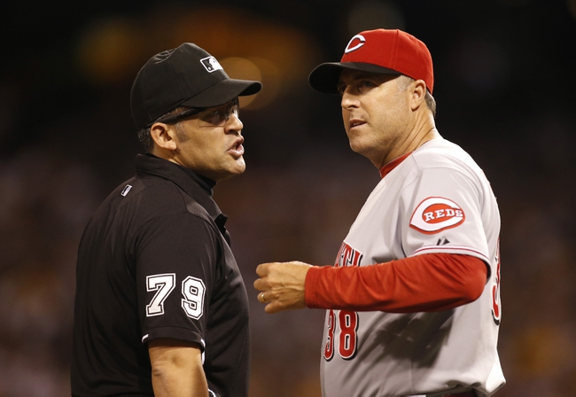 Aug 29, 2014; Pittsburgh, PA, USA; Third base umpire Manny Gonzalez (79) talks with Cincinnati Reds manager Bryan Price (38) against the Pittsburgh Pirates during the seventh inning at PNC Park. The Pirates won 2-1. Mandatory Credit: Charles LeClaire-USA TODAY Sports
