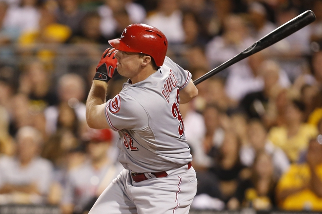 Aug 29, 2014; Pittsburgh, PA, USA; Cincinnati Reds right fielder Jay Bruce (32) singles against the Pittsburgh Pirates during the seventh inning at PNC Park. The Pirates won 2-1. Mandatory Credit: Charles LeClaire-USA TODAY Sports