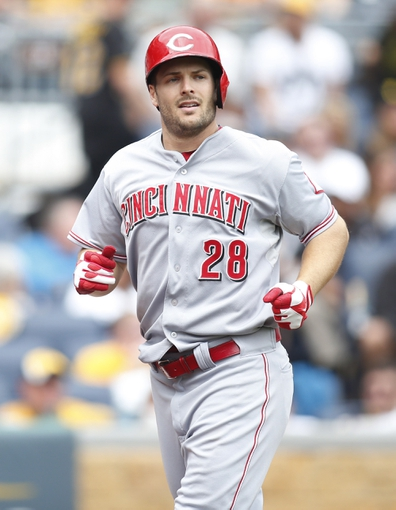 Aug 31, 2014; Pittsburgh, PA, USA; Cincinnati Reds left fielder Chris Heisey (28) reacts after crossing home plate with a solo home run against the Pittsburgh Pirates during the fifth inning at PNC Park. The Reds won 3-2. Mandatory Credit: Charles LeClaire-USA TODAY Sports