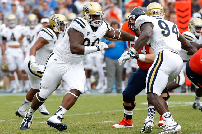 Aug 30, 2014; Charlottesville, VA, USA; UCLA Bruins defensive lineman Ellis McCarthy (90) chases the ball carrier against the Virginia Cavaliers at Scott Stadium. Mandatory Credit: Geoff Burke-USA TODAY Sports