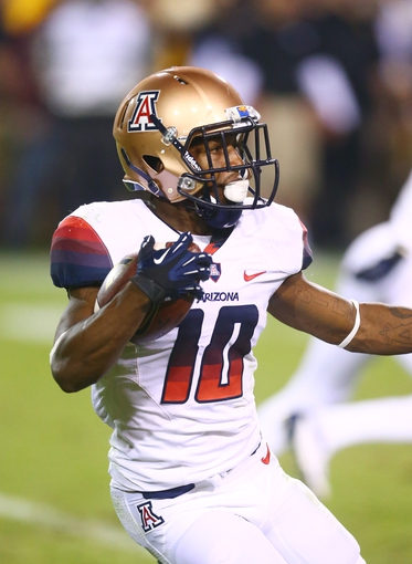 Nov 30, 2013; Tempe, AZ, USA; Arizona Wildcats wide receiver Samajie Grant (10) against the Arizona State Sun Devils in the 87th annual Territorial Cup at Sun Devil Stadium. Mandatory Credit: Mark J. Rebilas-USA TODAY Sports