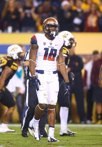 Nov 30, 2013; Tempe, AZ, USA; Arizona Wildcats wide receiver Terrence Miller (18) against the Arizona State Sun Devils in the 87th annual Territorial Cup at Sun Devil Stadium. Mandatory Credit: Mark J. Rebilas-USA TODAY Sports