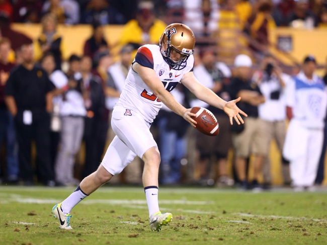 Nov 30, 2013; Tempe, AZ, USA; Arizona Wildcats punter Drew Riggleman against the Arizona State Sun Devils in the 87th annual Territorial Cup at Sun Devil Stadium. Mandatory Credit: Mark J. Rebilas-USA TODAY Sports