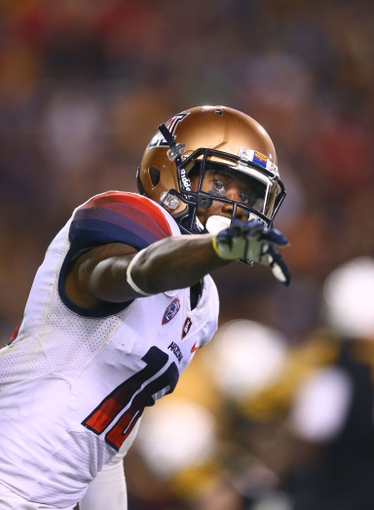 Nov 30, 2013; Tempe, AZ, USA; Arizona Wildcats wide receiver Garic Wharton (16) reacts against the Arizona State Sun Devils in the 87th annual Territorial Cup at Sun Devil Stadium. Mandatory Credit: Mark J. Rebilas-USA TODAY Sports
