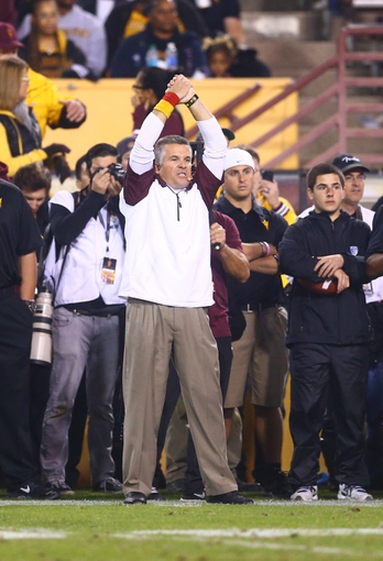 Nov 30, 2013; Tempe, AZ, USA; Arizona State Sun Devils head coach Todd Graham reacts against the Arizona Wildcats in the 87th annual Territorial Cup at Sun Devil Stadium. Mandatory Credit: Mark J. Rebilas-USA TODAY Sports