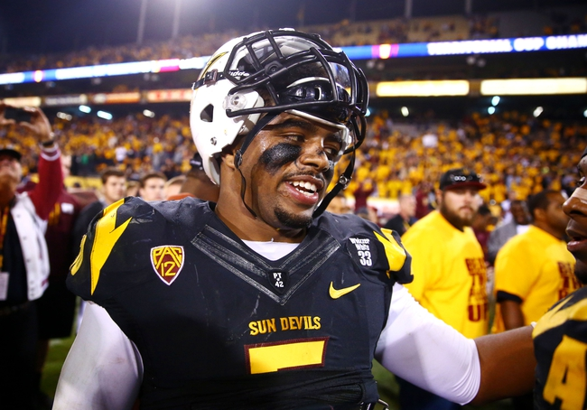 Nov 30, 2013; Tempe, AZ, USA; Arizona State Sun Devils linebacker Chris Young (5)  against the Arizona Wildcats in the 87th annual Territorial Cup at Sun Devil Stadium. Mandatory Credit: Mark J. Rebilas-USA TODAY Sports