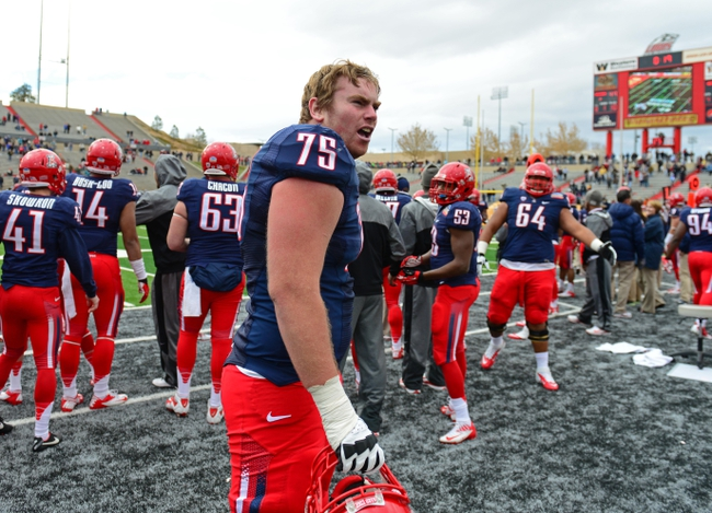 Dec. 15, 2012; Albuquerque, NM, USA; Arizona Wildcats offensive lineman Shane Zink (75) against the Nevada Wolf Pack in the 2012 New Mexico Bowl at University Stadium. Arizona defeated Nevada 49-48. Mandatory Credit: Mark J. Rebilas-USA TODAY Sports