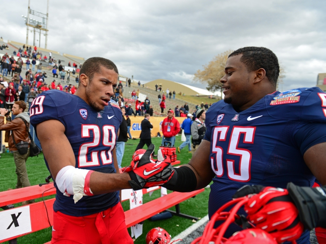 Dec. 15, 2012; Albuquerque, NM, USA; Arizona Wildcats wide receiver Austin Hill (29) celebrates with defensive tackle Jowyn Ward (55) in the closing seconds of the game against the Nevada Wolf Pack in the 2012 New Mexico Bowl at University Stadium. Mandatory Credit: Mark J. Rebilas-USA TODAY Sports