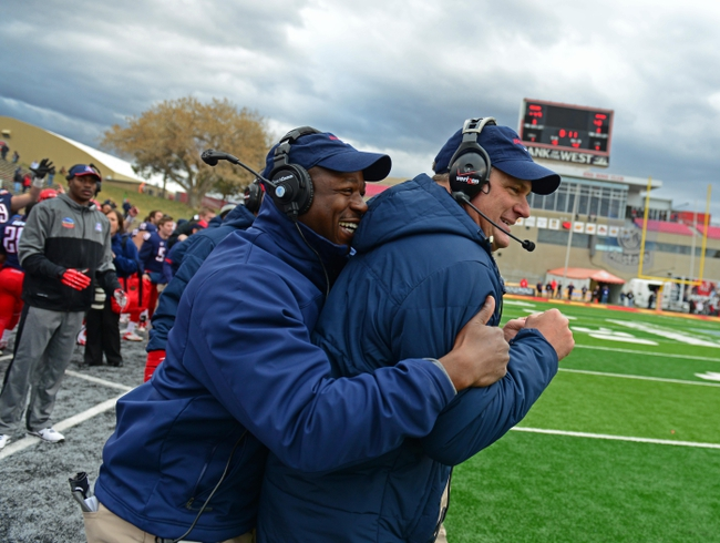 Dec. 15, 2012; Albuquerque, NM, USA; Arizona Wildcats head coach Rich Rodriguez (right) is hugged by wide receivers coach Tony Dews on the sidelines in the closing seconds of the game against the Nevada Wolf Pack in the 2012 New Mexico Bowl at University Stadium. Mandatory Credit: Mark J. Rebilas-USA TODAY Sports