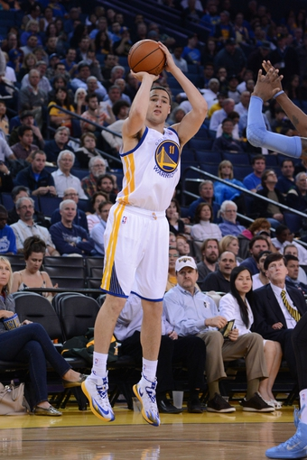 April 10, 2014; Oakland, CA, USA; Golden State Warriors guard Klay Thompson (11) shoots the basketball during the third quarter against the Denver Nuggets at Oracle Arena. The Nuggets defeated the Warriors 100-99. Mandatory Credit: Kyle Terada-USA TODAY Sports