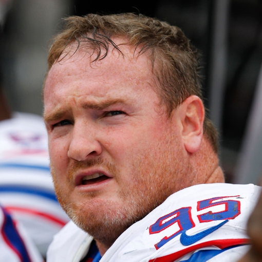 Sep 15, 2013; Orchard Park, NY, USA; Buffalo Bills defensive tackle Kyle Williams (95) on the sideline against the Carolina Panthers at Ralph Wilson Stadium. Buffalo beats Carolina 27 to 26.  Mandatory Credit: Timothy T. Ludwig-USA TODAY Sports