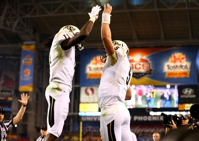 Jan 1, 2014; Glendale, AZ, USA; Central Florida Knights quarterback Blake Bortles (5) celebrates a touchdown with wide receiver Breshad Perriman (11) against the Baylor Bears during the Fiesta Bowl at University of Phoenix Stadium. Central Florida defeated Baylor 52-42. Mandatory Credit: Mark J. Rebilas-USA TODAY Sports